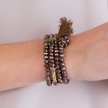 Crystal And Hammered Gold Tone Tassel Bracelet In Brown/gold